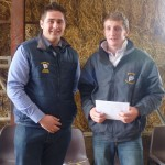 George Hollinshead accepting his prize from Drew Patrick