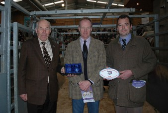 Alasdair Houston being awarded the prize by Society President Ralph Needham and Ben Harman
