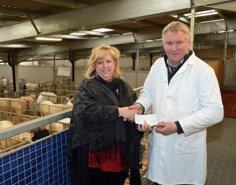 Wil Owen presented a cheque for £361 raised in a raffle at the Welsh Winter Fair to Llyn Hughes of the Welsh Air Ambulance
