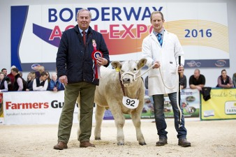 """Charolais Steer Class winner Ashley Bothwell with """"Cheeky Charlie being presented by BCCS Chief Executive David Benson"""