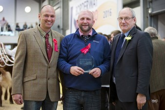 Ian Bell & Paul Stobart accepting the prize for Best Breed Society Trade Stand from H & H Director Michael Scott